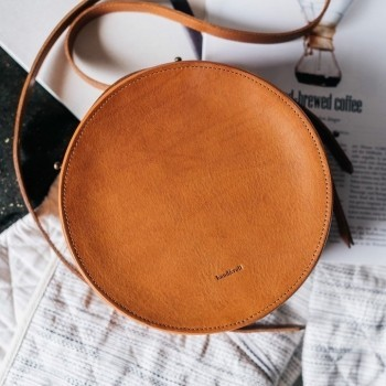 Circular leather cross body bag Sol